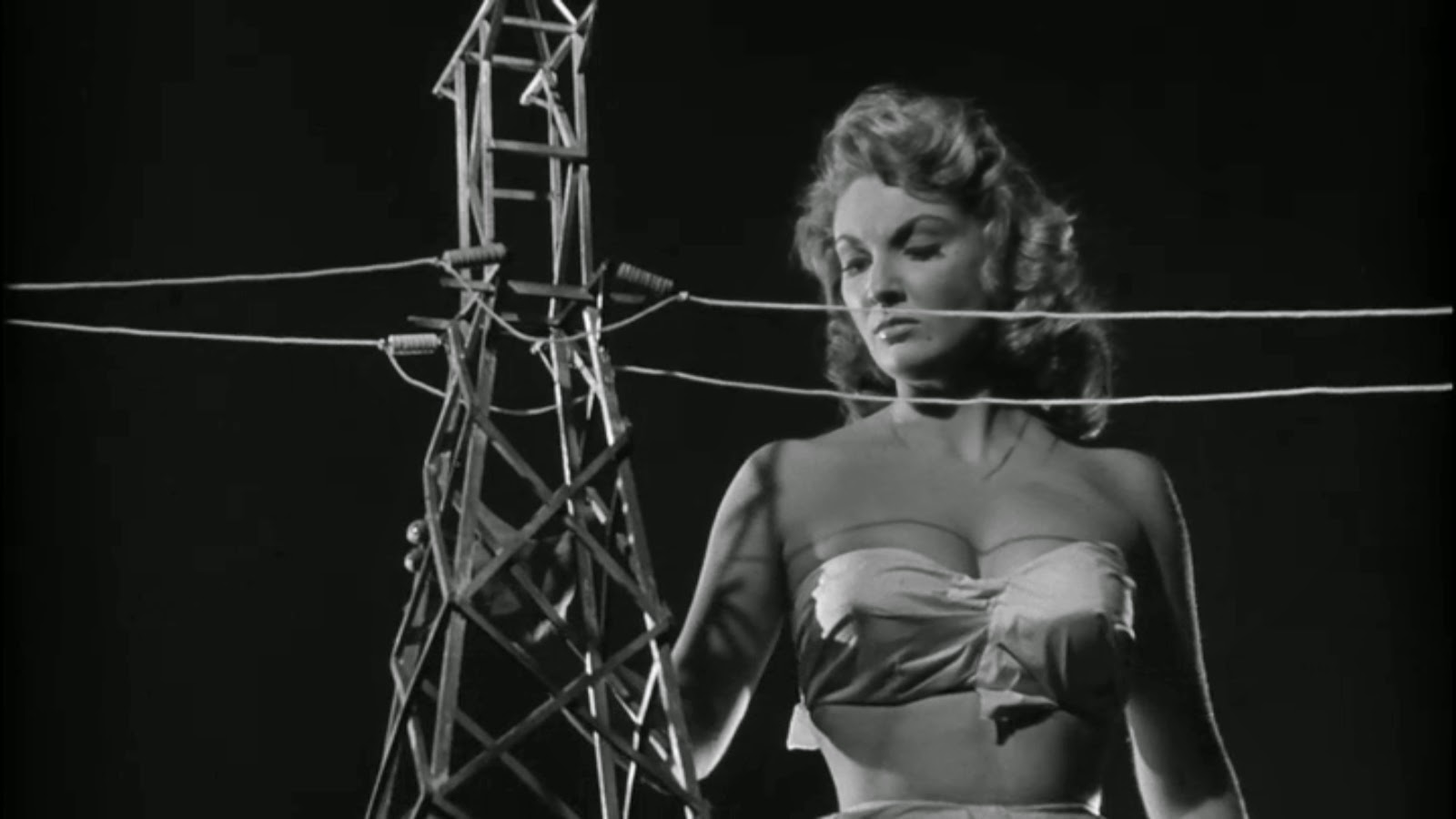 Allison Hayes rampages through town in Attack of the 50 Foot Woman (1958)