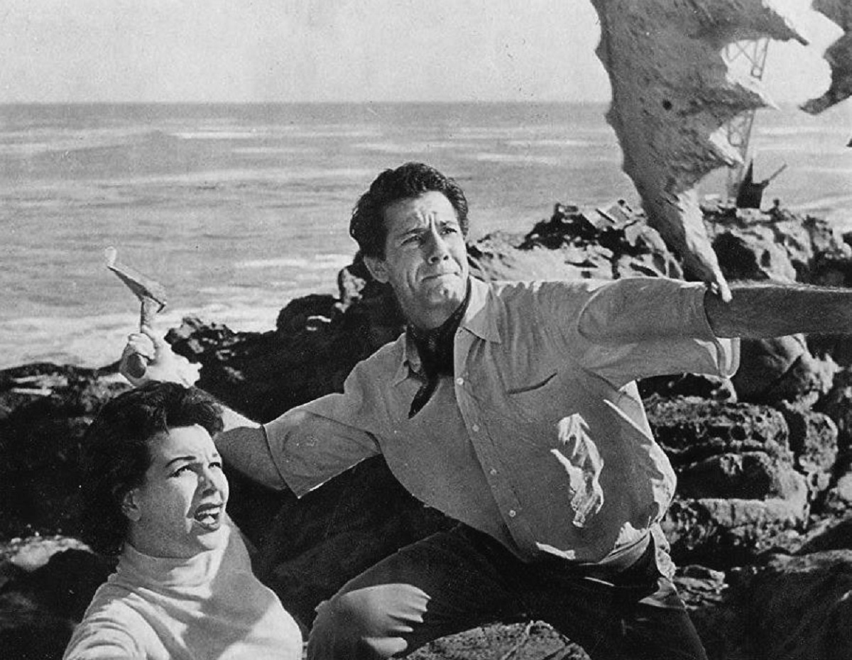 Pamela Duncan and Richard Garland fend off attack by a giant crab claw in Attack of the Crab Monsters (1957)