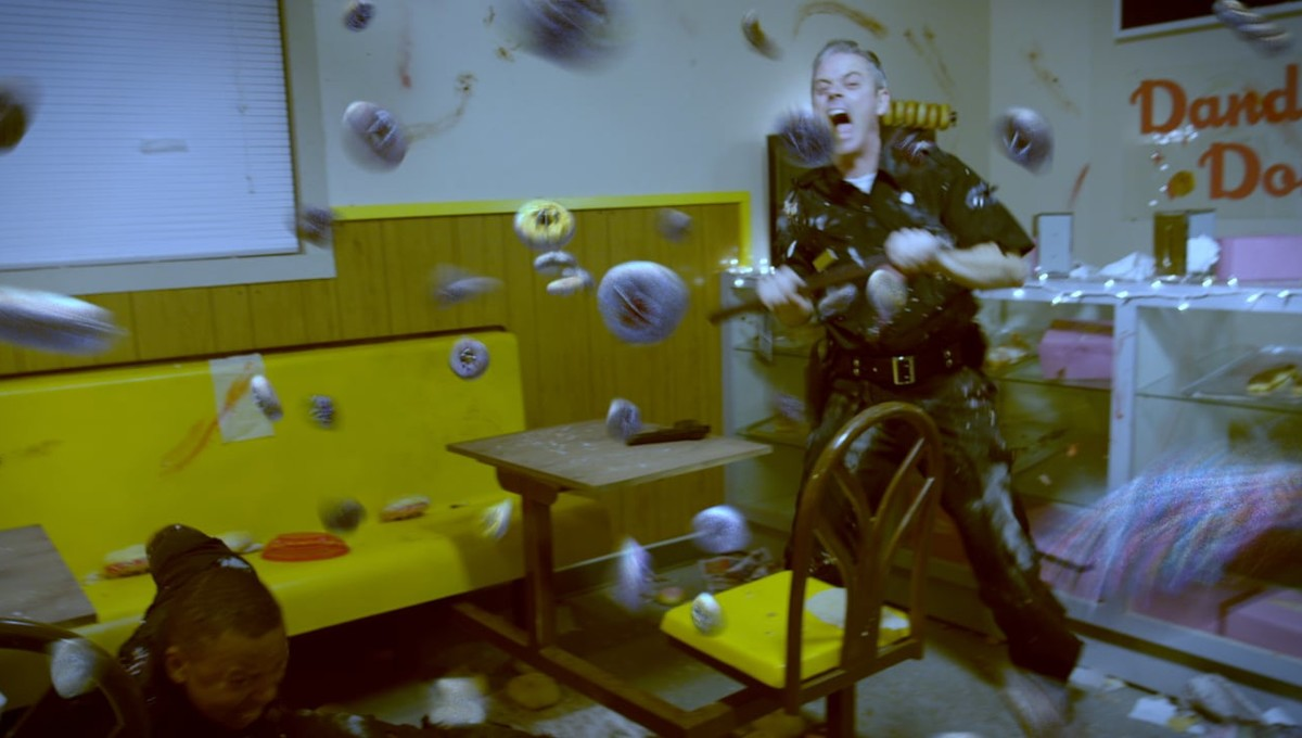 C. Thomas Howell under attack by killer donuts in Attack of the Killer Donuts (2016)