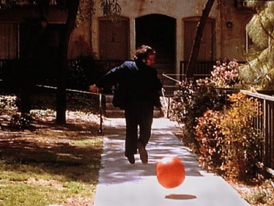 A killer tomato pursues a human victim in Attack of the Killer Tomatoes (1978)