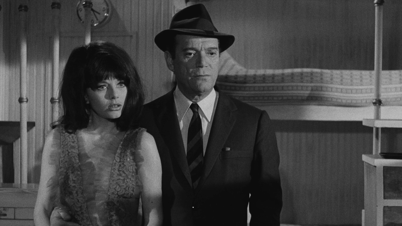 Interpol agent Al Pereira (Eddie Constantine) with Sophie Hardy in Attack of the Robots (1966)