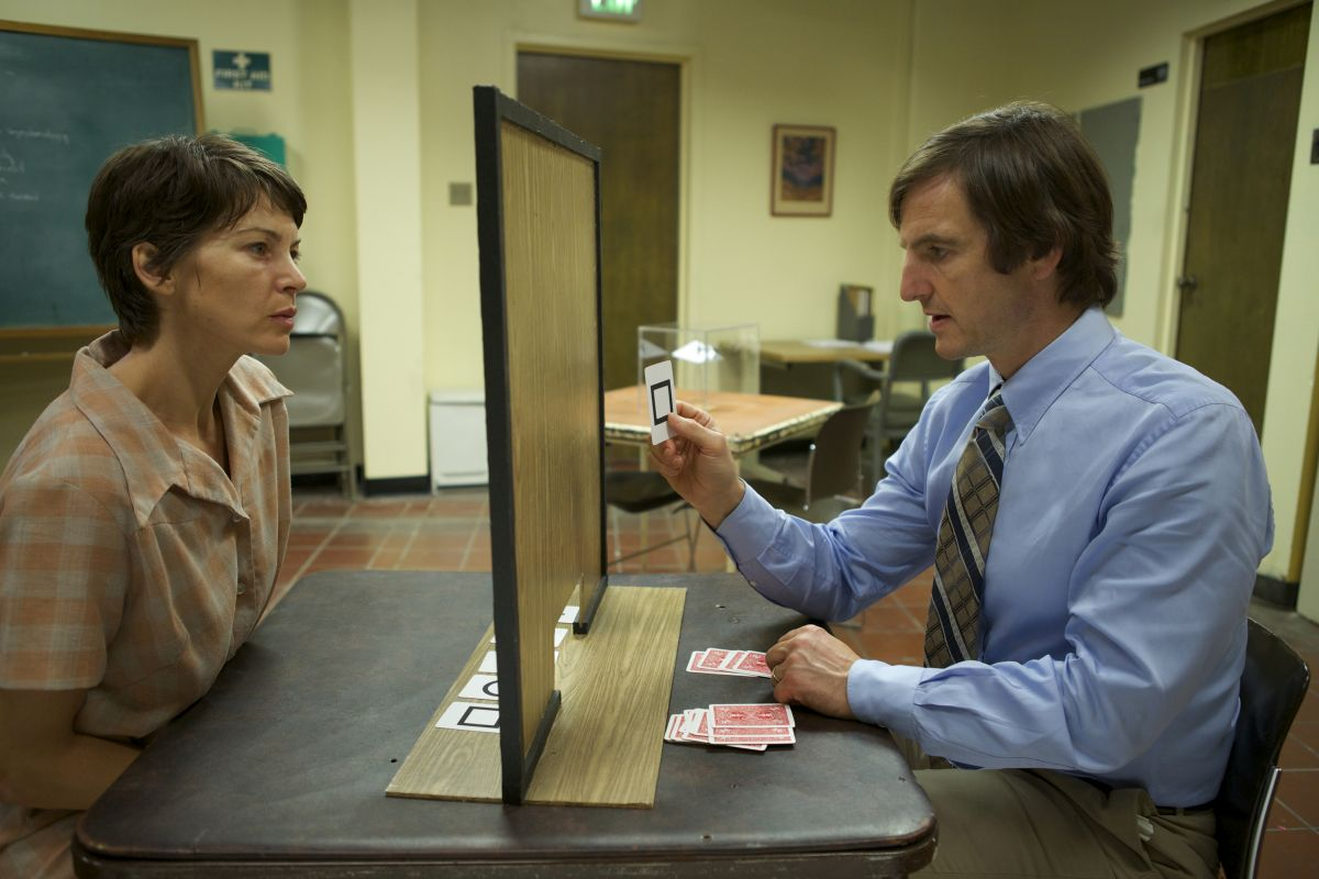 Rya Kihlstedt undergoes psychic tests from William Mapother in The Atticus Institute (2015)