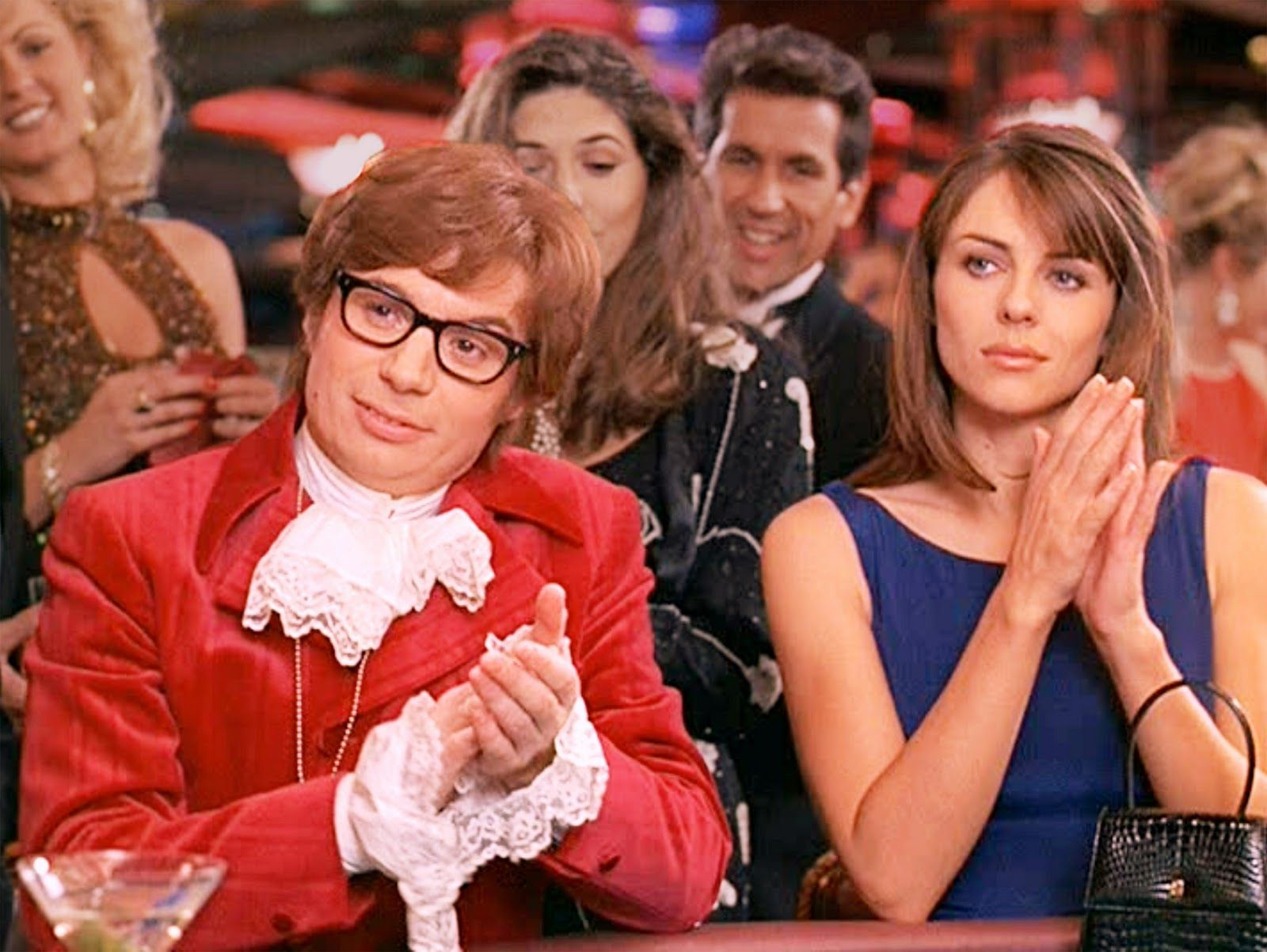 Mike Myers as secret agent Austin Powers, cryogenically defrosted from the 1960s, and Vanessa Kensington (Elizabeth Hurley) in Austin Powers, International Man of Mystery (1997)