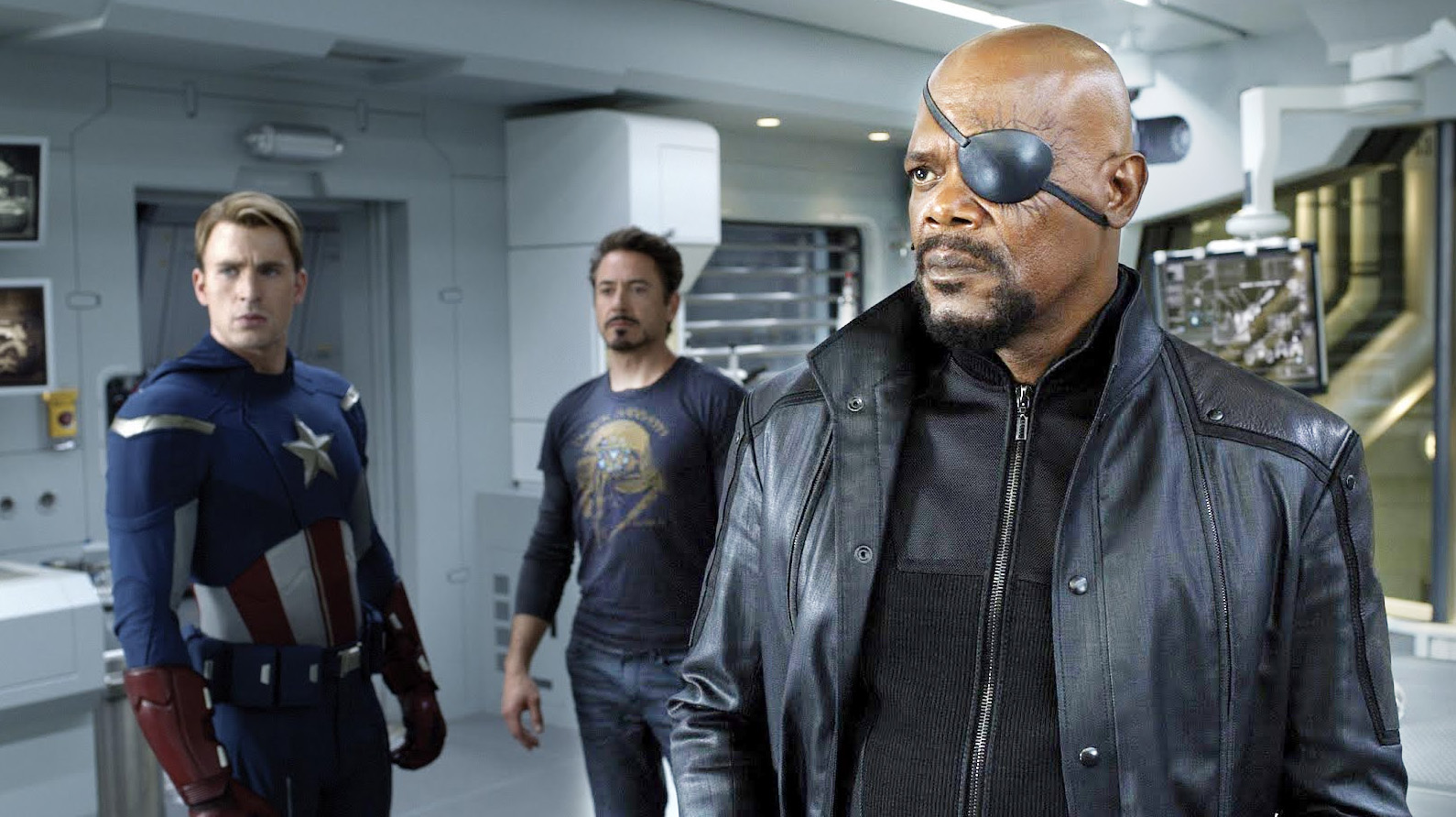 Chris Evans as Thor, Robert Downey Jr as Tony Stark and Samuel L. Jackson as Nick Fury in The Avengers (2012)