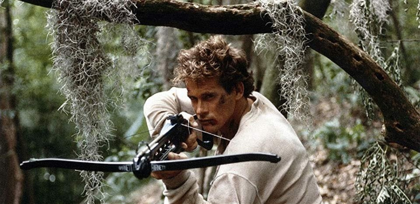 Michael Dudikoff forced to participate in a barehands survival hunt in the bayous in Avenging Force (1986)