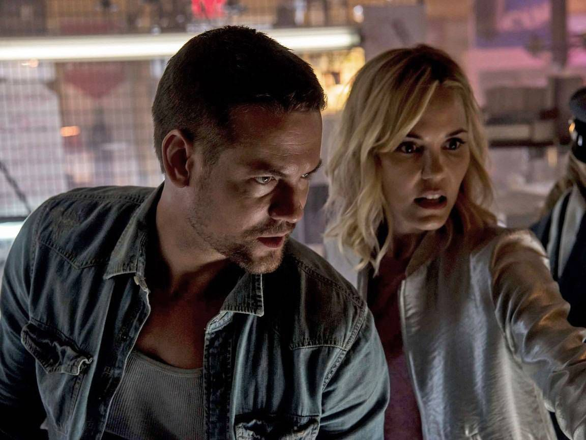 Husband and wife Shane West and Leslie Bibb make a discovery amid the contents of a storage locker in Awakening the Zodiac (2017)