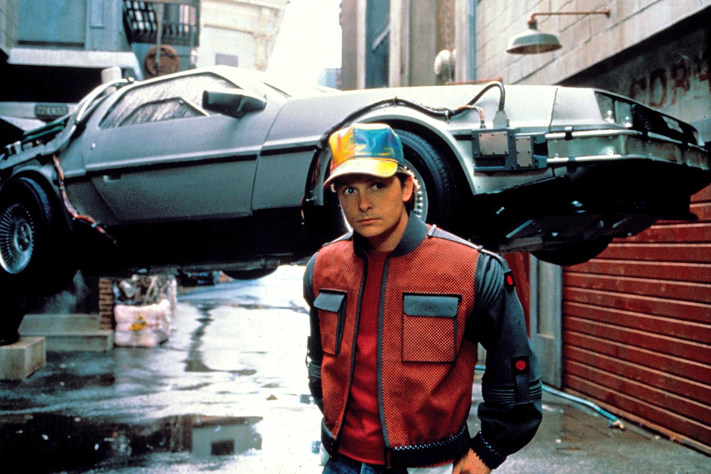 Marty McFly (Michael J. Fox) with flying DeLorean visits the future in Back to the Future Part II (1989)