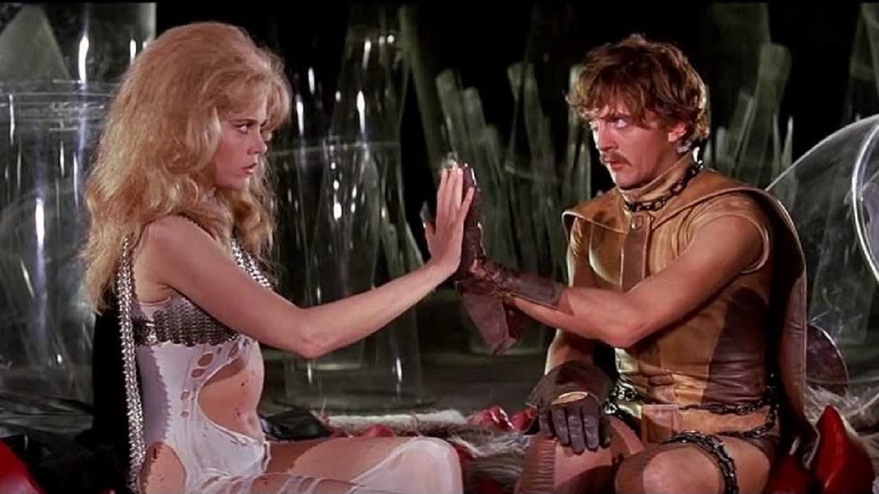 Jane Fonda and David Hemmings touch hands in Barbarella (1968)