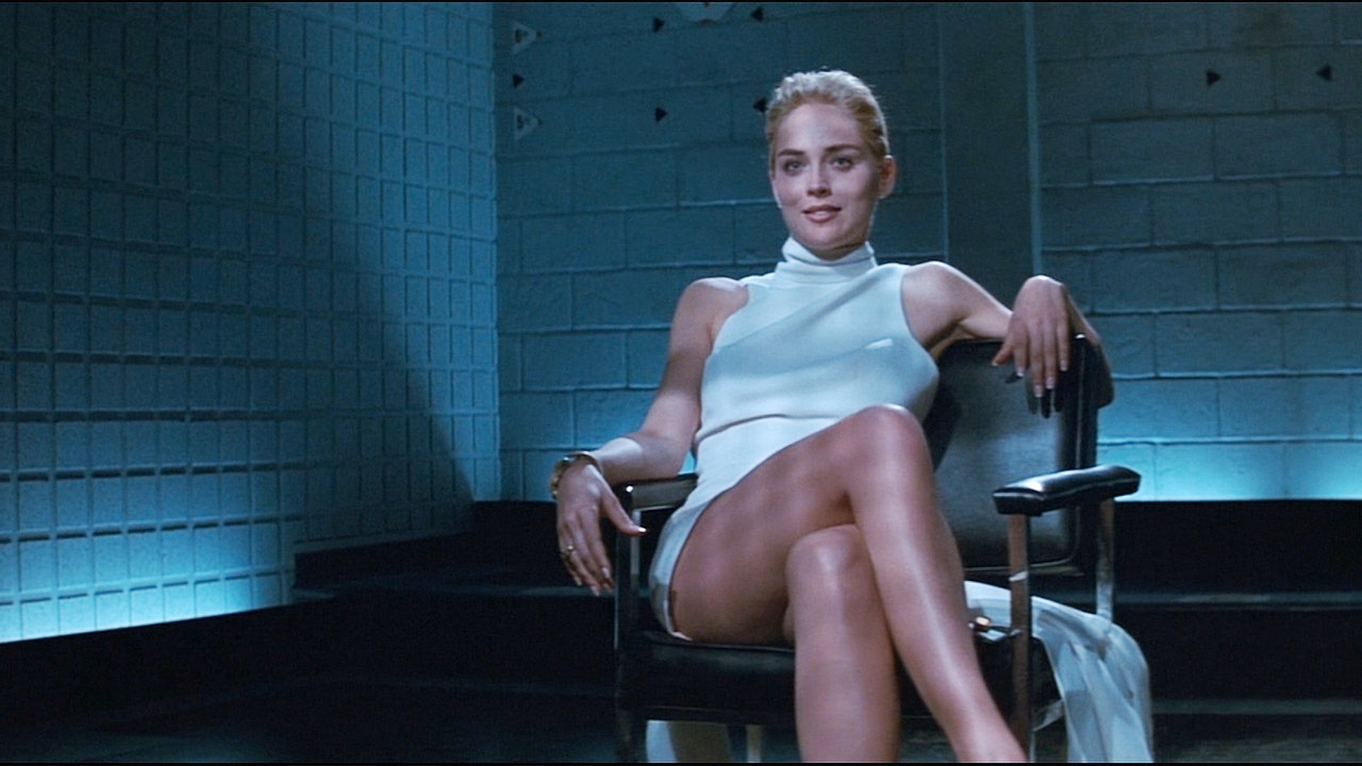 Sharon Stone flashes her lack of underwear during a police interrogation in Basic Instinct (1992)