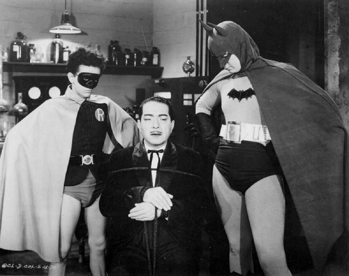 Batman (Lewis Wilson) and Robin (Douglas Croft) flank Prince Tito Daka (J. Carrol Naish) in Batman (1943)