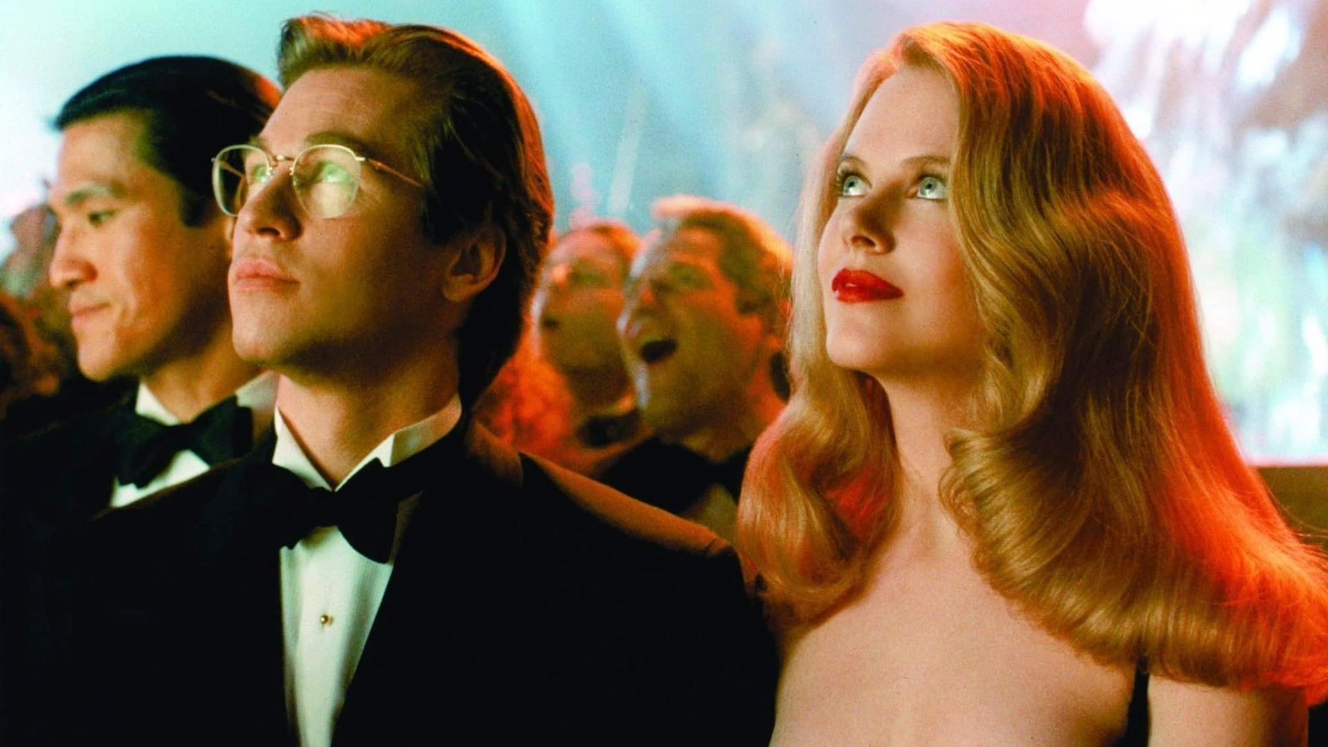 Bruce Wayne (Val Kilmer) and Dr Chase Meridian (Nicole Kidman) in Batman Forever (1995)