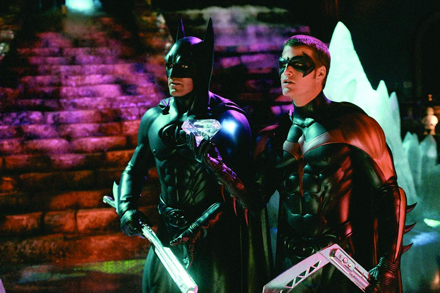Batman (George Clooney) and Robin (Chris O'Donnell) on ice skates in Batman & Robin (1997)