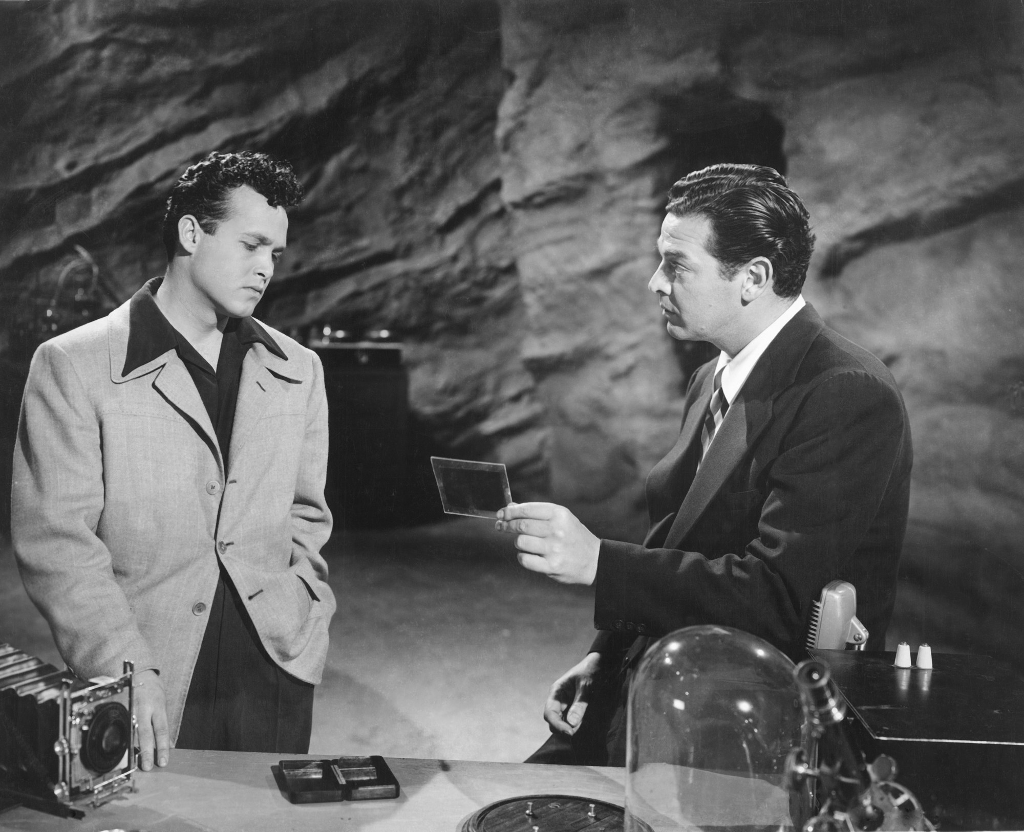 Dick Grayson (John Duncan) and Bruce Wayne (Robert Lowery) in the Batcave in Batman and Robin (1949)