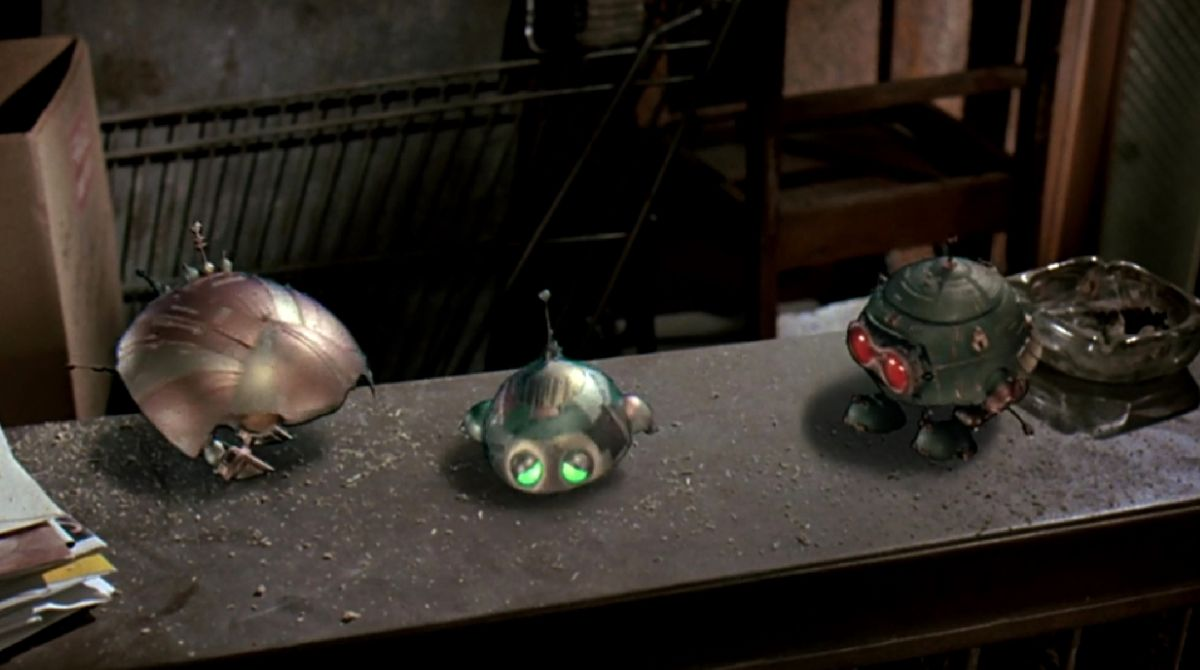 Assorted miniature UFOs in Batteries Not Included (1987)