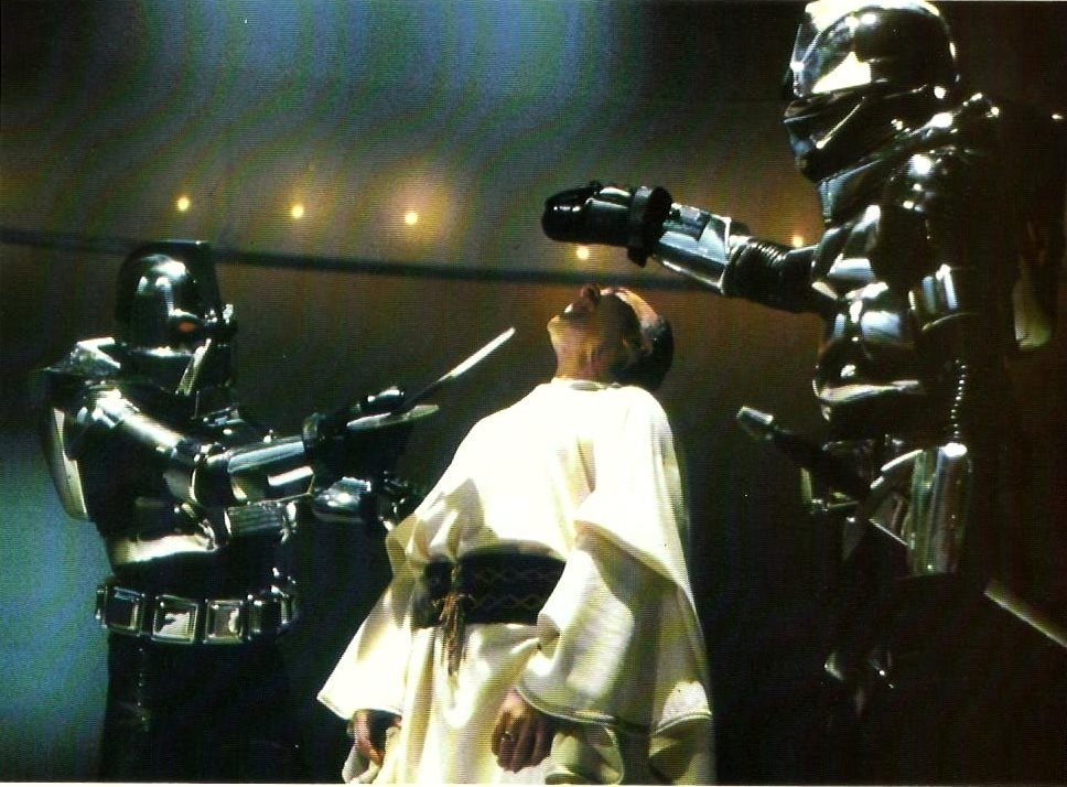 The Cylons execute Count Baltar (John Colicos) in Battlestar Galactica (1978)