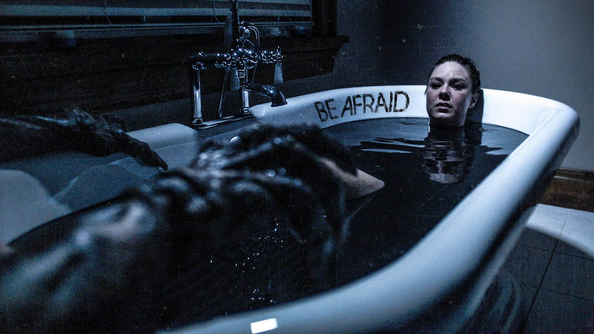 Jaimi Paige takes a bath as one of he creatures advance on her in Be Afraid (2017)