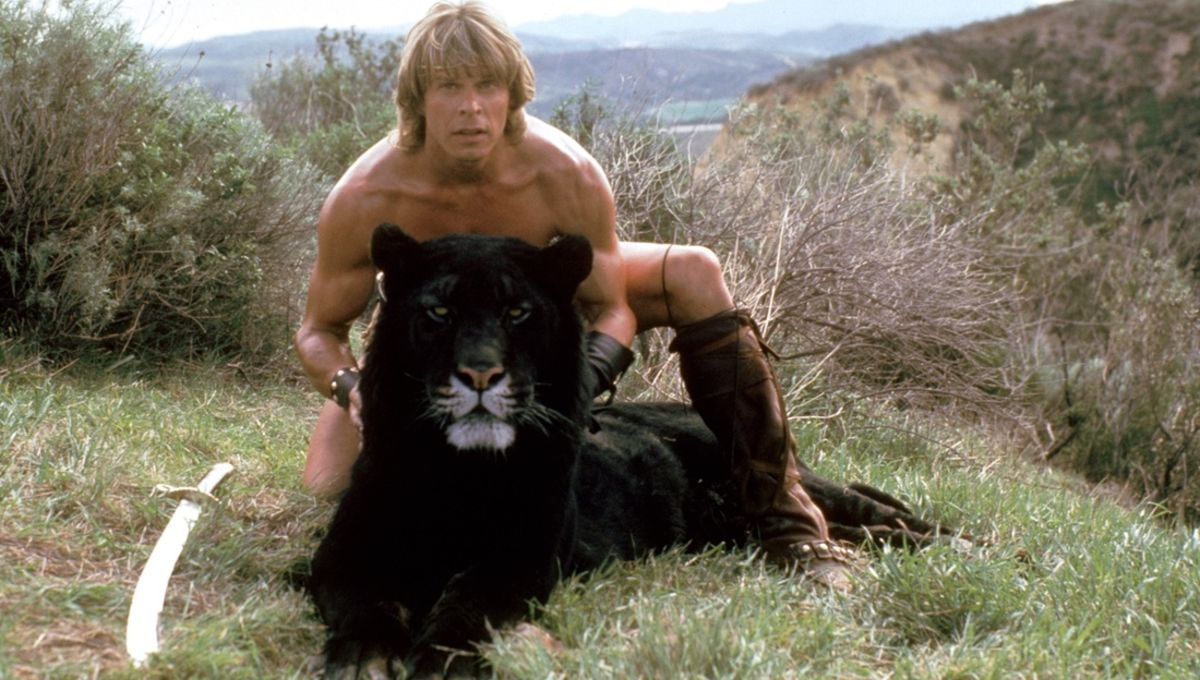 Marc Singer as Dar with Ruh the tiger in The Beastmaster (1982)