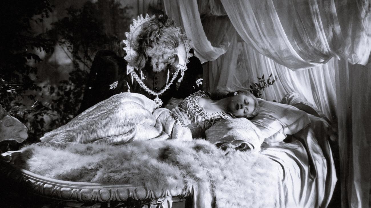 The Beast (Jean Marais) peeps in on a sleeping Beauty (Josette Day) in Beauty and the Beast (1946)