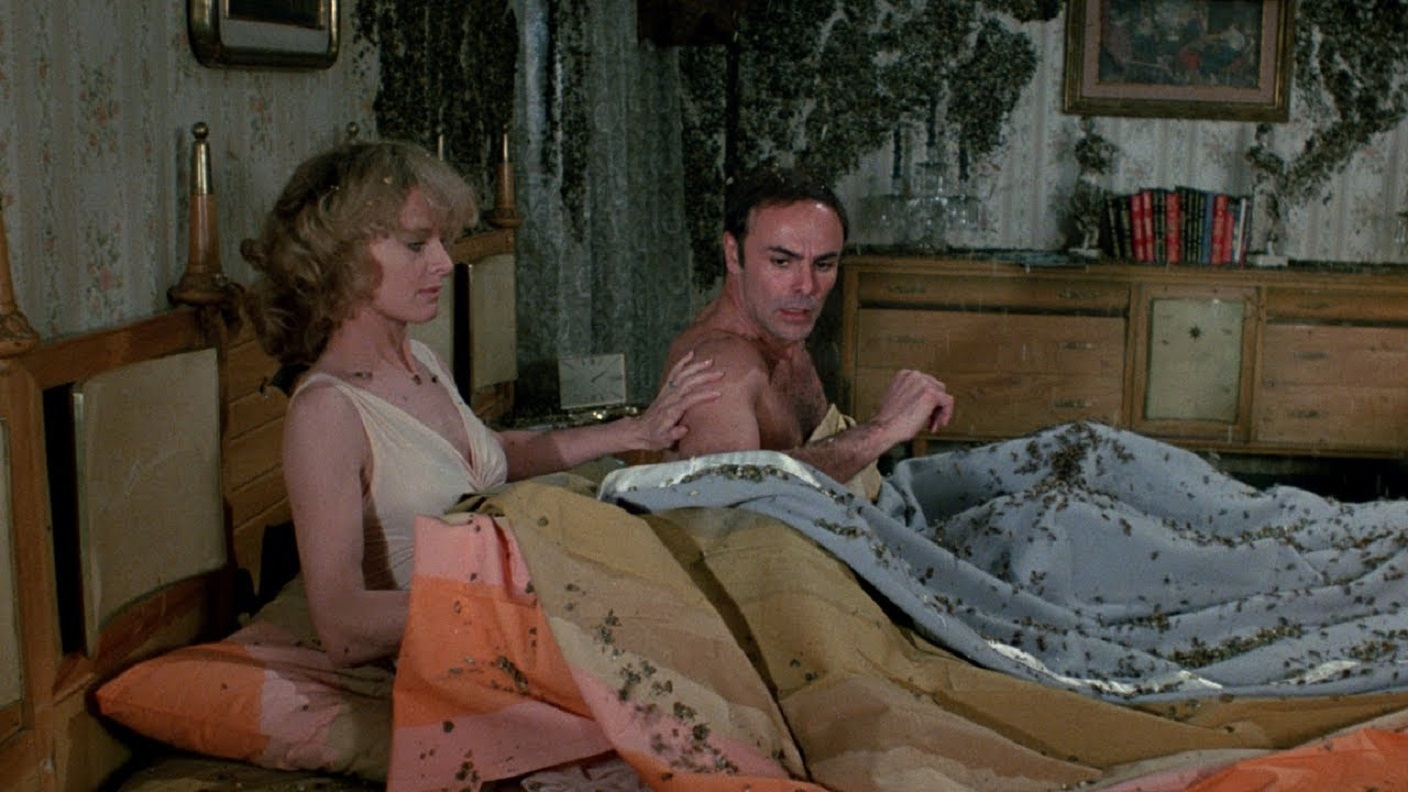 Angel Tompkins and John Saxon wake up in a bed covered in bees in The Bees (1978)