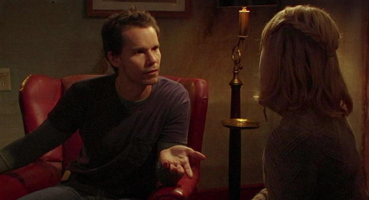 Serial killer Leslie Vernon (Nathan Baesal) explains himself to interviewer Angela Goethals in Behind the Mask: The Rise of Leslie Vernon (2006)