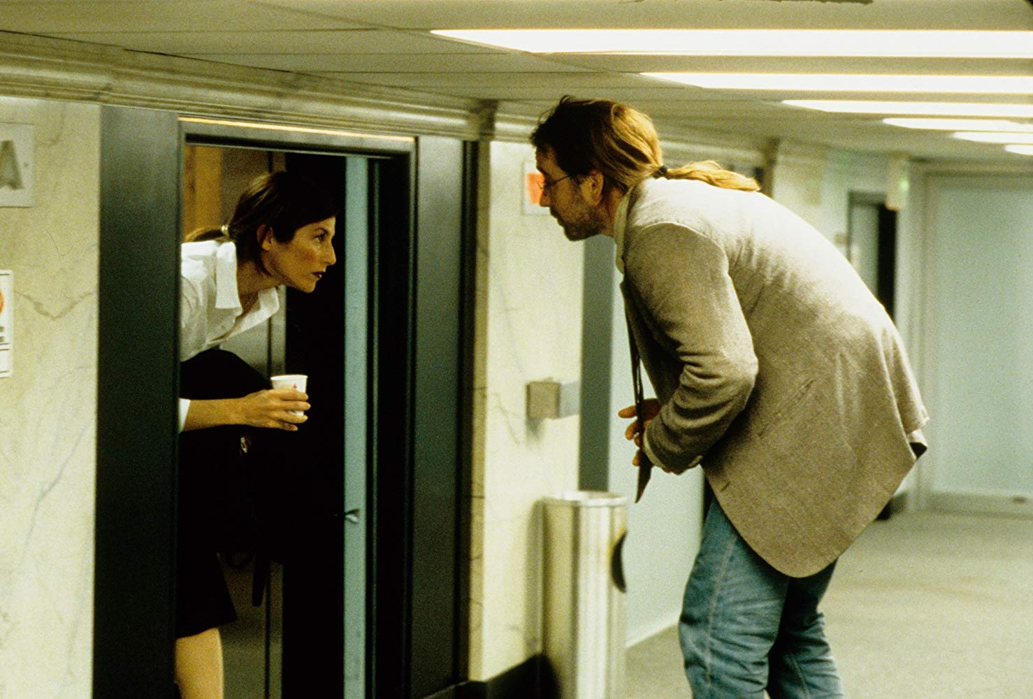 John Cusack and co-worker Catherine Keener in their workplace on the on the 7½th Floor in Being John Malkovich (1999)