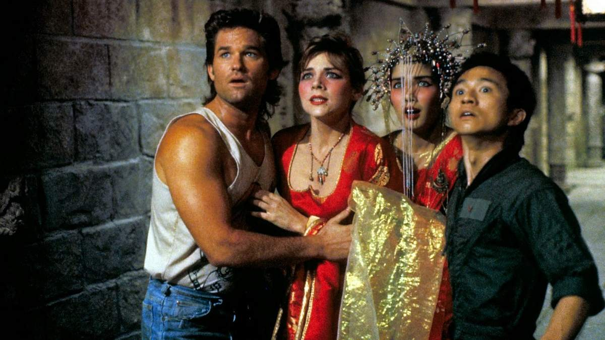 Jack Burton (Kurt Russell) with Gracie Law (Kim Cattrall), and Jack's friend Wang Chi (Dennis Dun) with his green-eyed bride (Suzee Pai) in Big Trouble in Little China (1986)