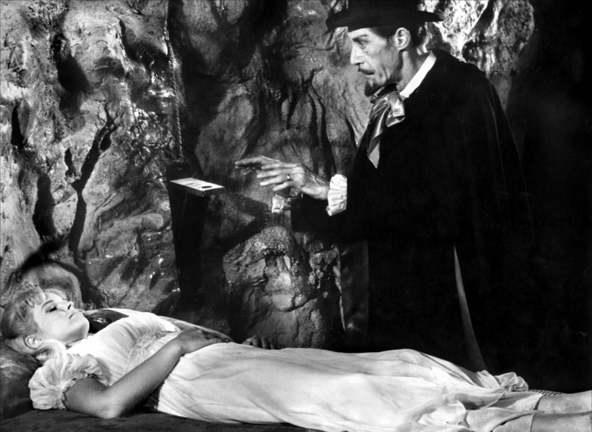 Dracula (John Carradine) approaches a sleeping Melinda Plowman in Billy the Kid Versus Dracula (1966)