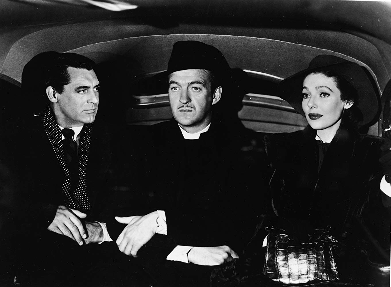 (l to r0 The angel Dudley (Cary Grant), bishop David Niven and the bishop's wife Loretta Young in The Bishop's Wife (1947)