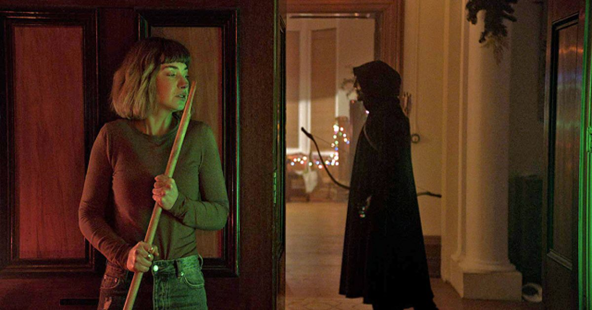Imogen Poots hides from the killer in Black Christmas (2019)