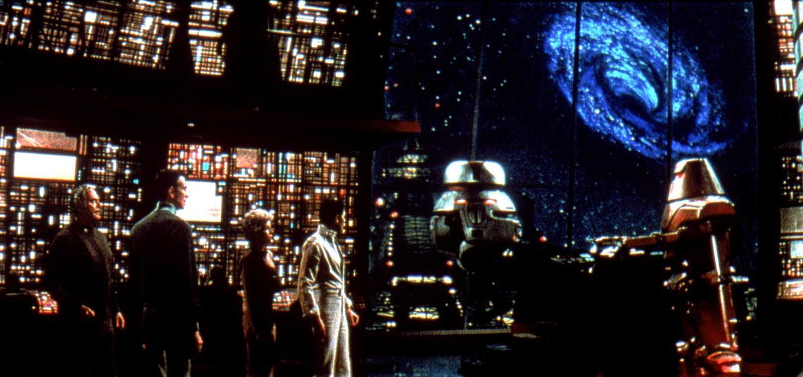 The Palomino crew - (l to r) Ernest Borgnine, Anthony Perkins, Yvette Mimieux and Joseph Bottoms along with the robots Vincent and Captain Star on the bridge of the Cygnus looking out at The Black Hole (1979)