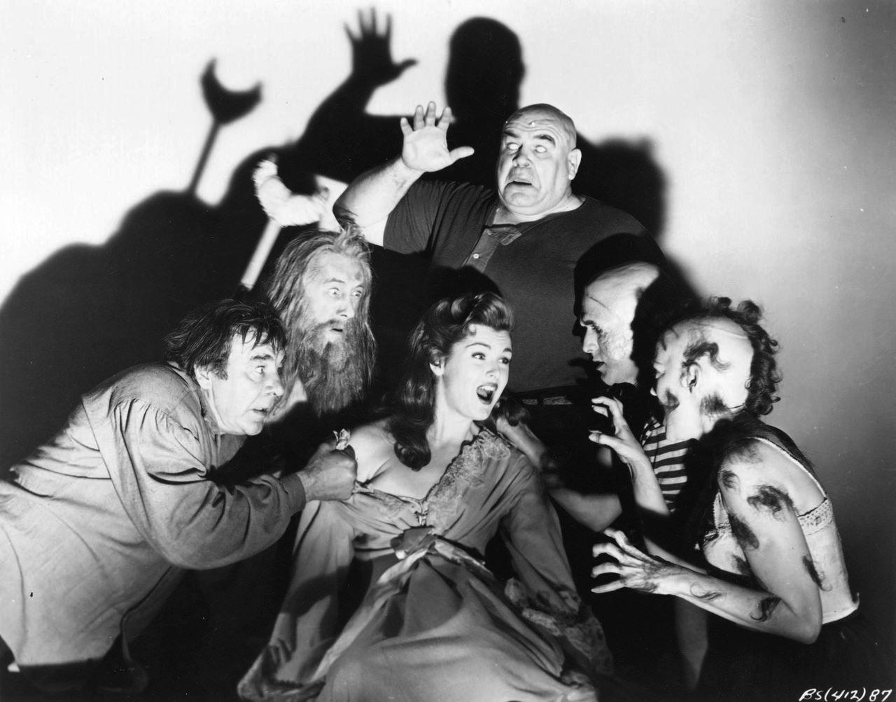 The deformities crowd in around Patricia Blake - (clockwise from left) Lon Chaney Jr, John Carradine, Tor Johnson, George Sawaya and Claire Carleton in The Black Sleep (1956)