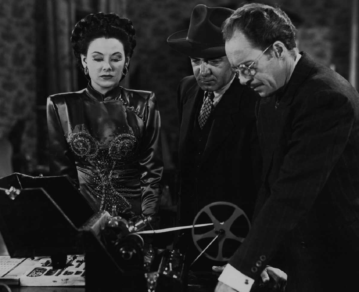 (l to r) Sombra (Carol Forman) and henchmen Anthony Warde and I. Stanford Jolley in The Black Widow (1947)