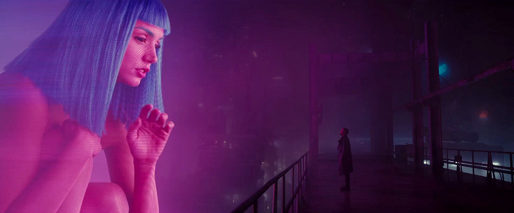 Ryan Gosling greeted by a giant-sized hologram in Blade Runner 2049 (2017)