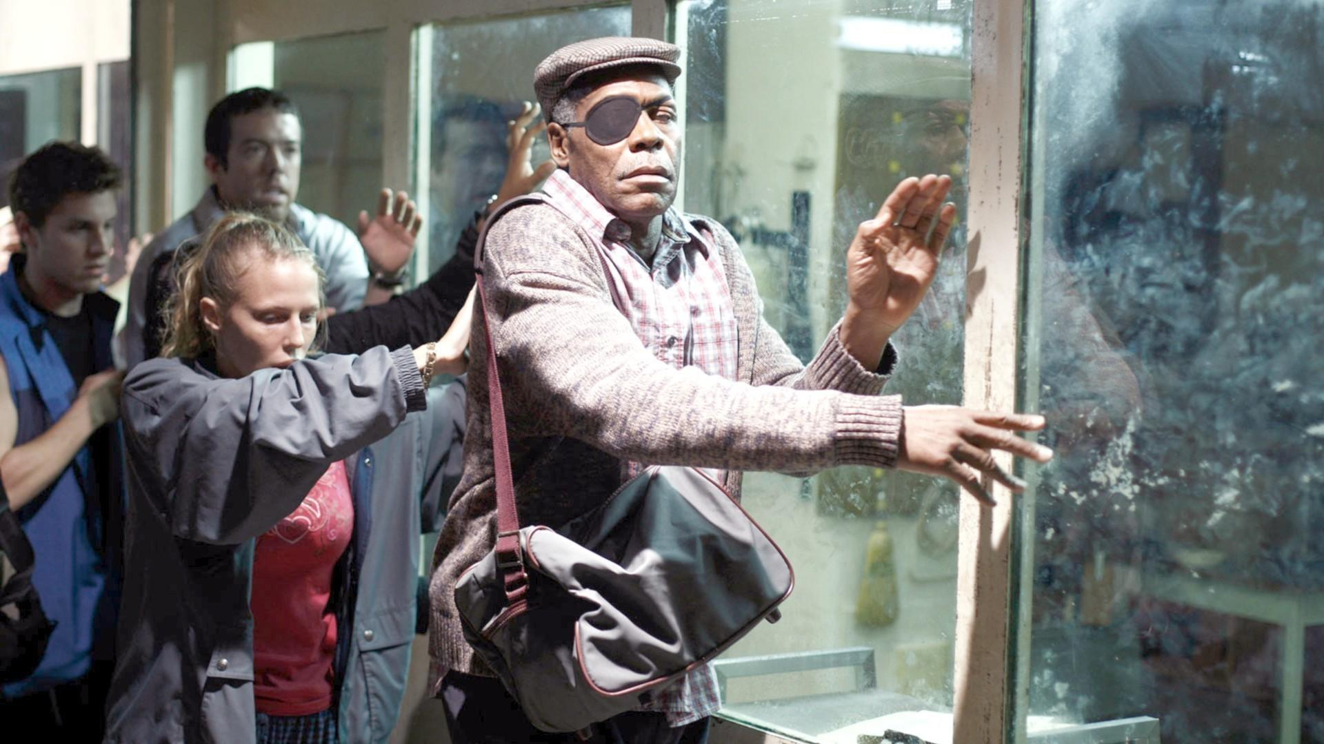 Danny Glover leads the blind in Blindness (2008)