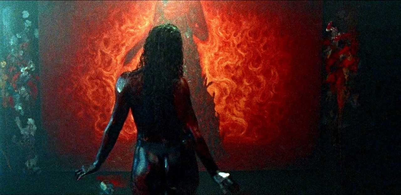 A blood-drenched Dora Madison sets out to complete her painting in Bliss (2019)