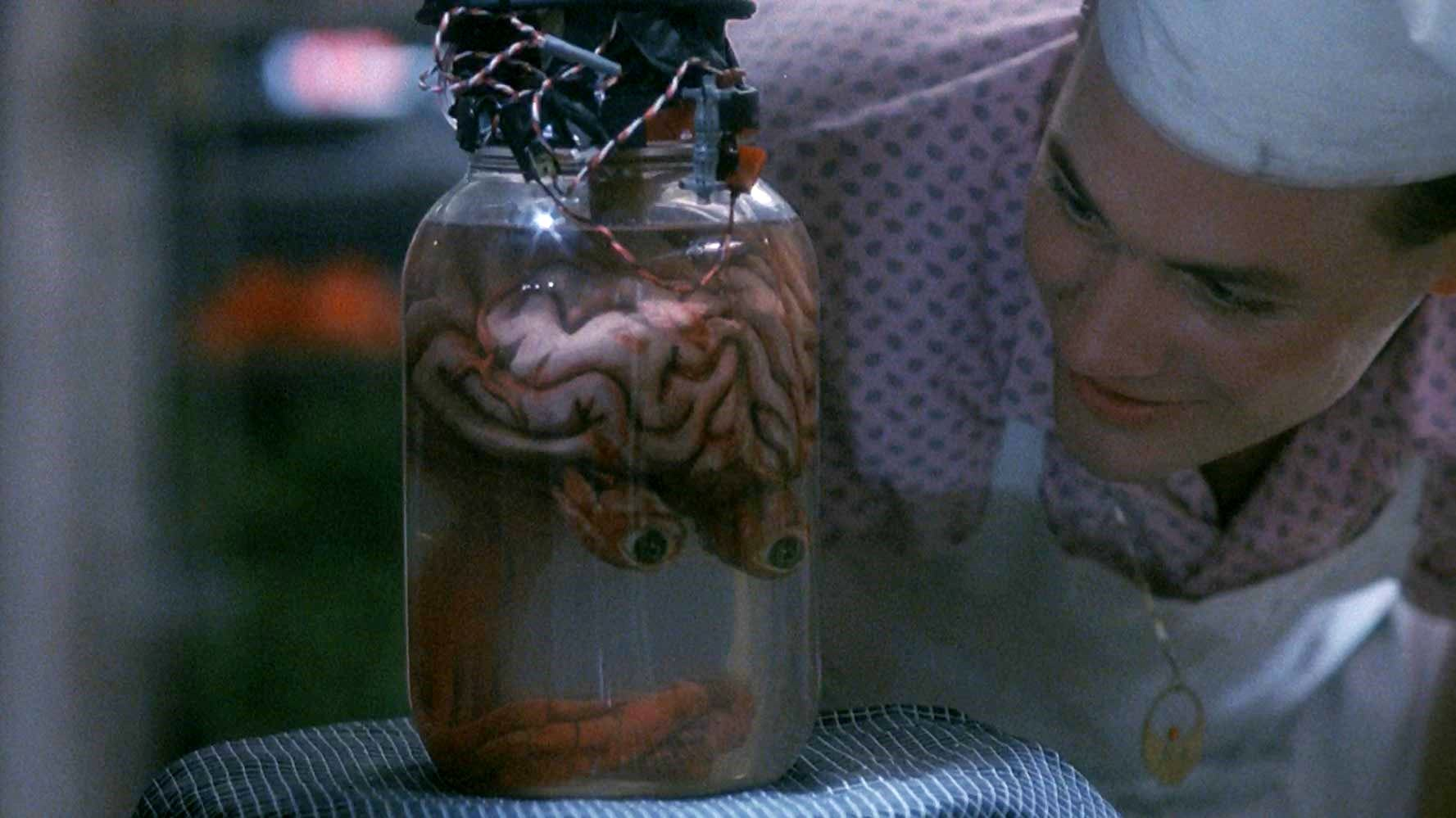 Rick Burks with the brain of Uncle Aylmer in Blood Diner (1987)