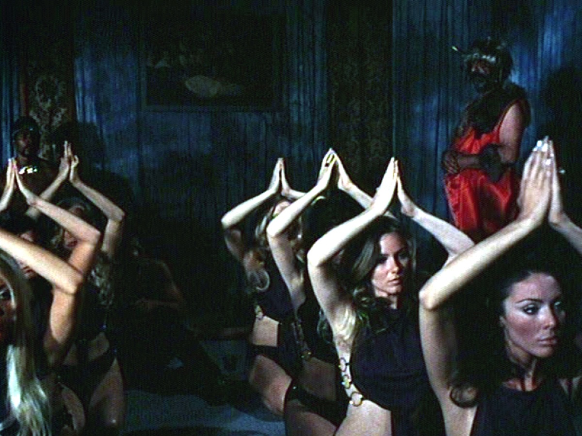 The occultists engaged in one of their rituals in Blood Orgy of the She-Devils (1972)