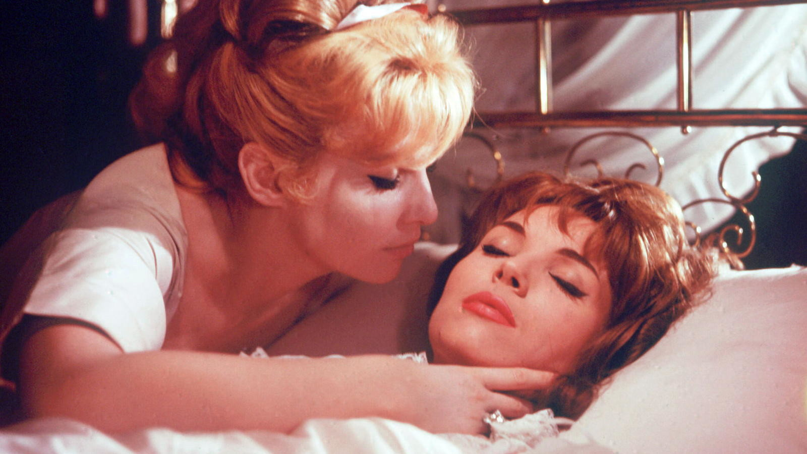 (l to r) Carmilla Von Karnstein (Annette Vadim) preys on the throat of Elsa Martinelli in Blood and Roses (1960)