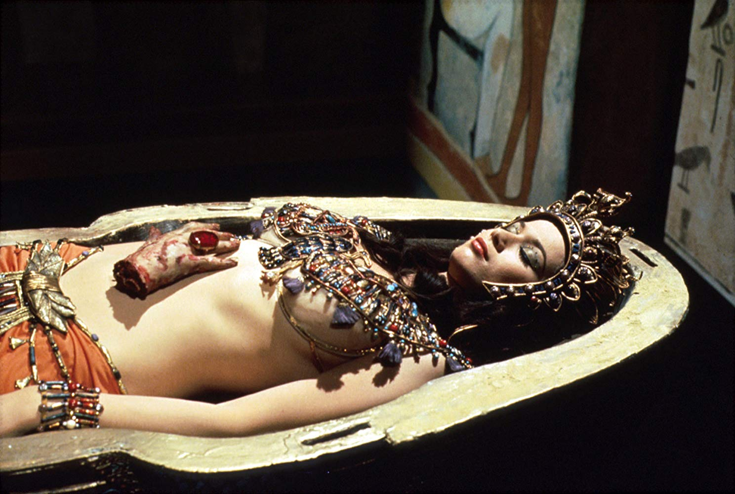 Valerie Leon as Queen Tera with severed hand in Blood from the Mummy's Tomb (1971)