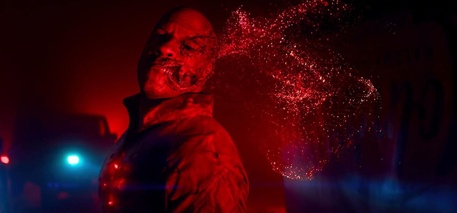 Vin Diesel's cheek explodes in a cloud of nanoparticles in Bloodshot (2020)