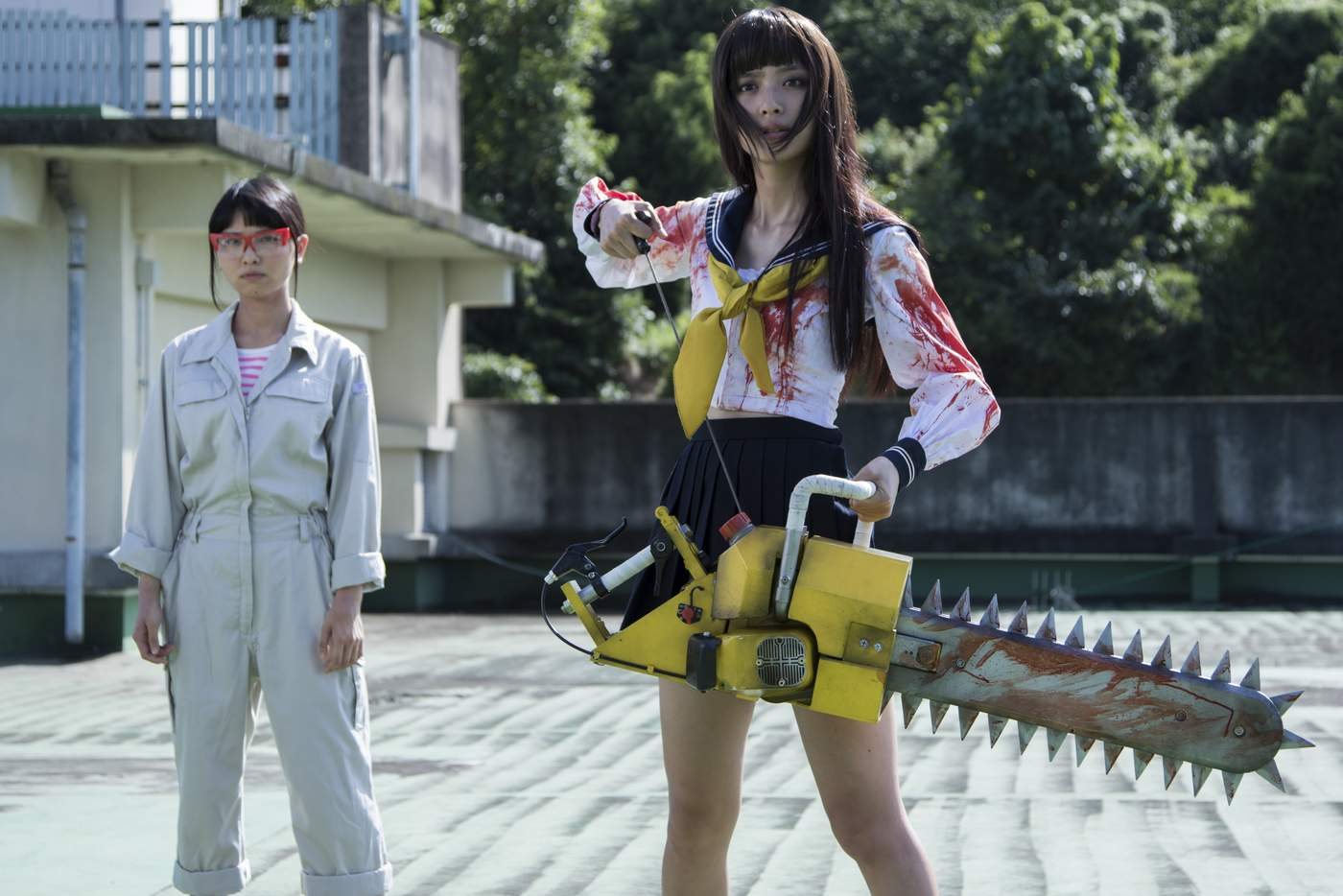 Rio Uchida (r) as Giko and (l) Seira Sato as Sayuri the Machine Shop girl in Bloody Chainsa Girl (2016)