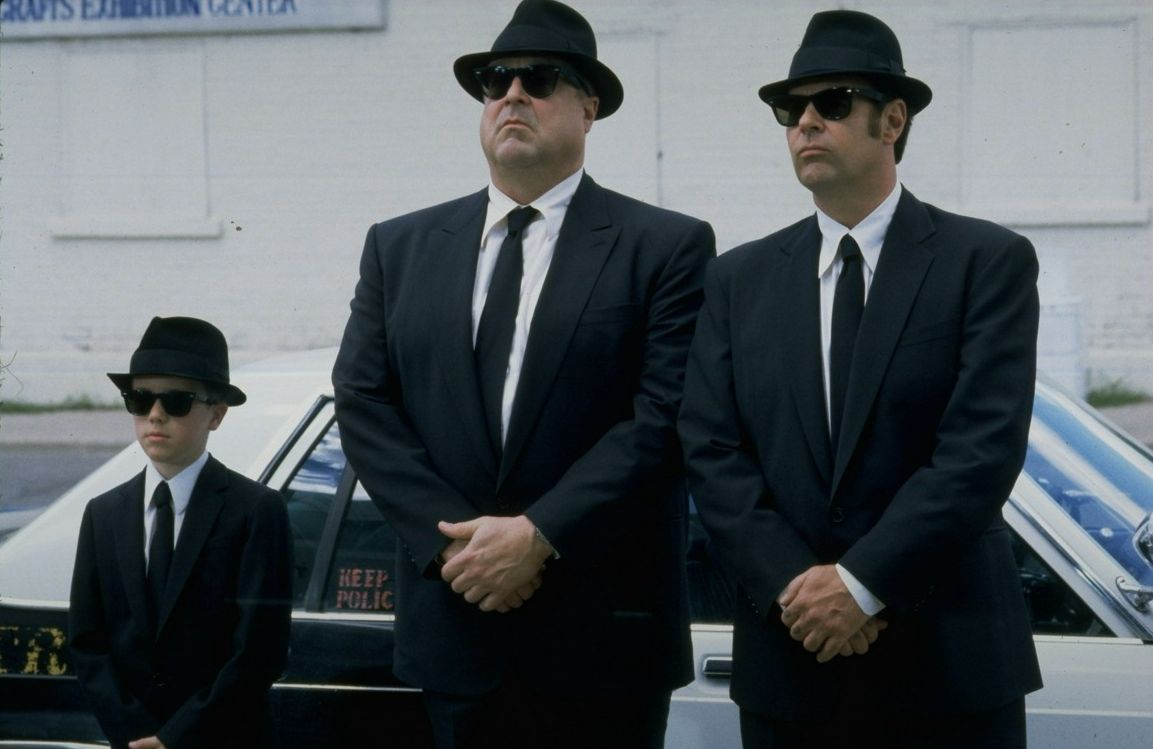 Thew Blues Brothers - (l to r) Buster (J. Evan Bonifant), Mighty Mack McTeer (John Goodman) and Elwood Blues (Dan Aykoyd) in Blues Brothers 2000 (1998)