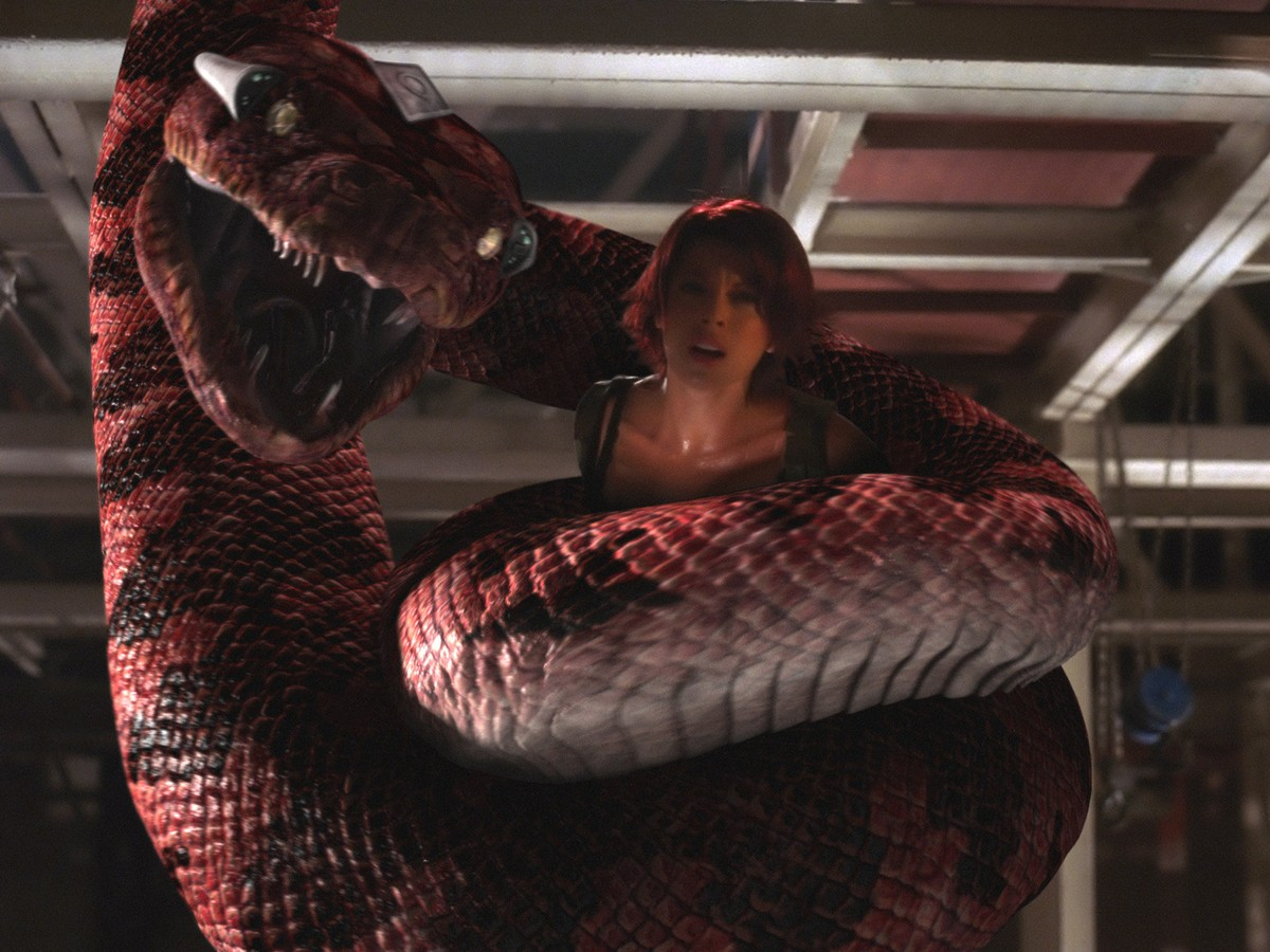 Angel Boris gets enwrapped in a giant snake in Boa vs Python (2004)