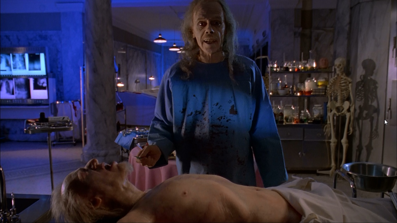 Director John Carpenter as the pun-cracking coroner and narrator in Body Bags (1993)