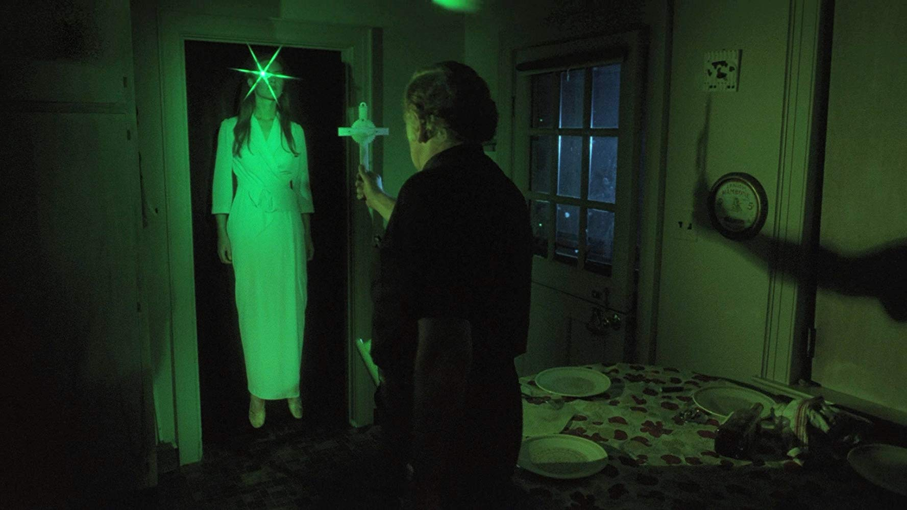 Priest Llewellyn Thomas attempts to exorcist a possessed Suzanna Love in The Boogey Man (1980)