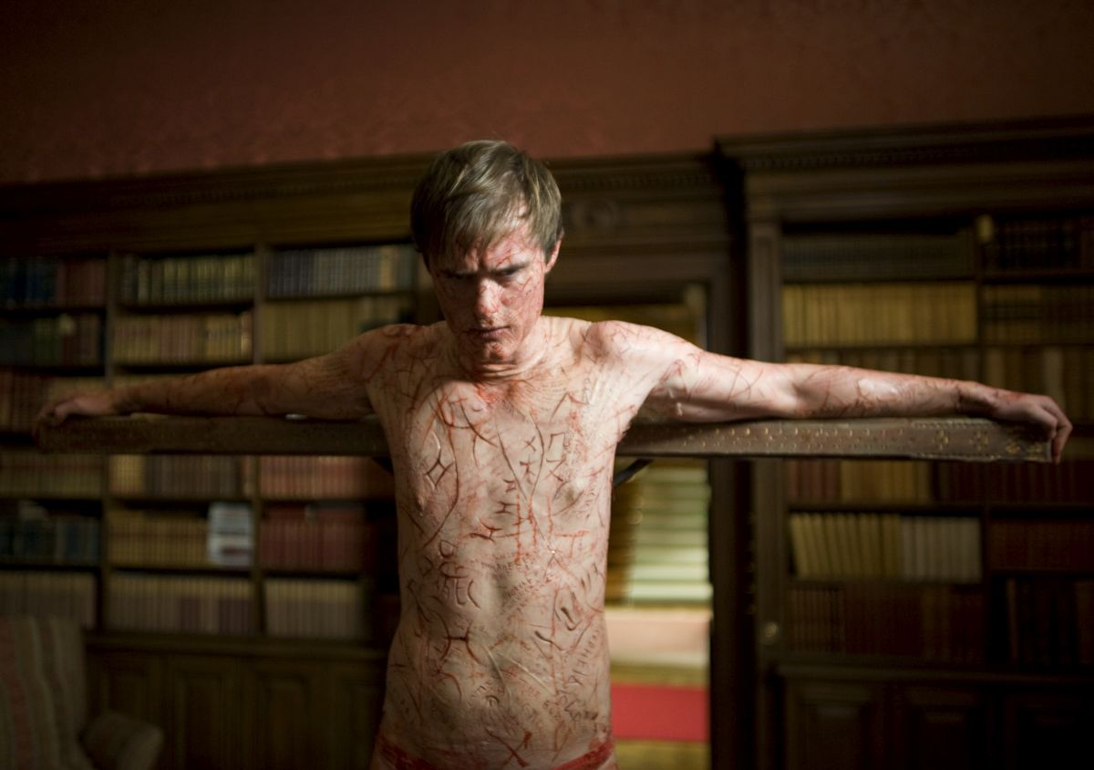 Simon McBeal (Jonas Armstrong) with his skin carved with the stories of the dead in Book of Blood (2009)