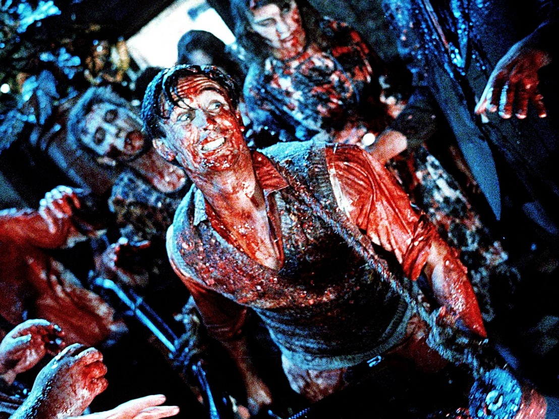 Tim Balme wades through zombie hordes and buckets of gore in Braindead (1992)