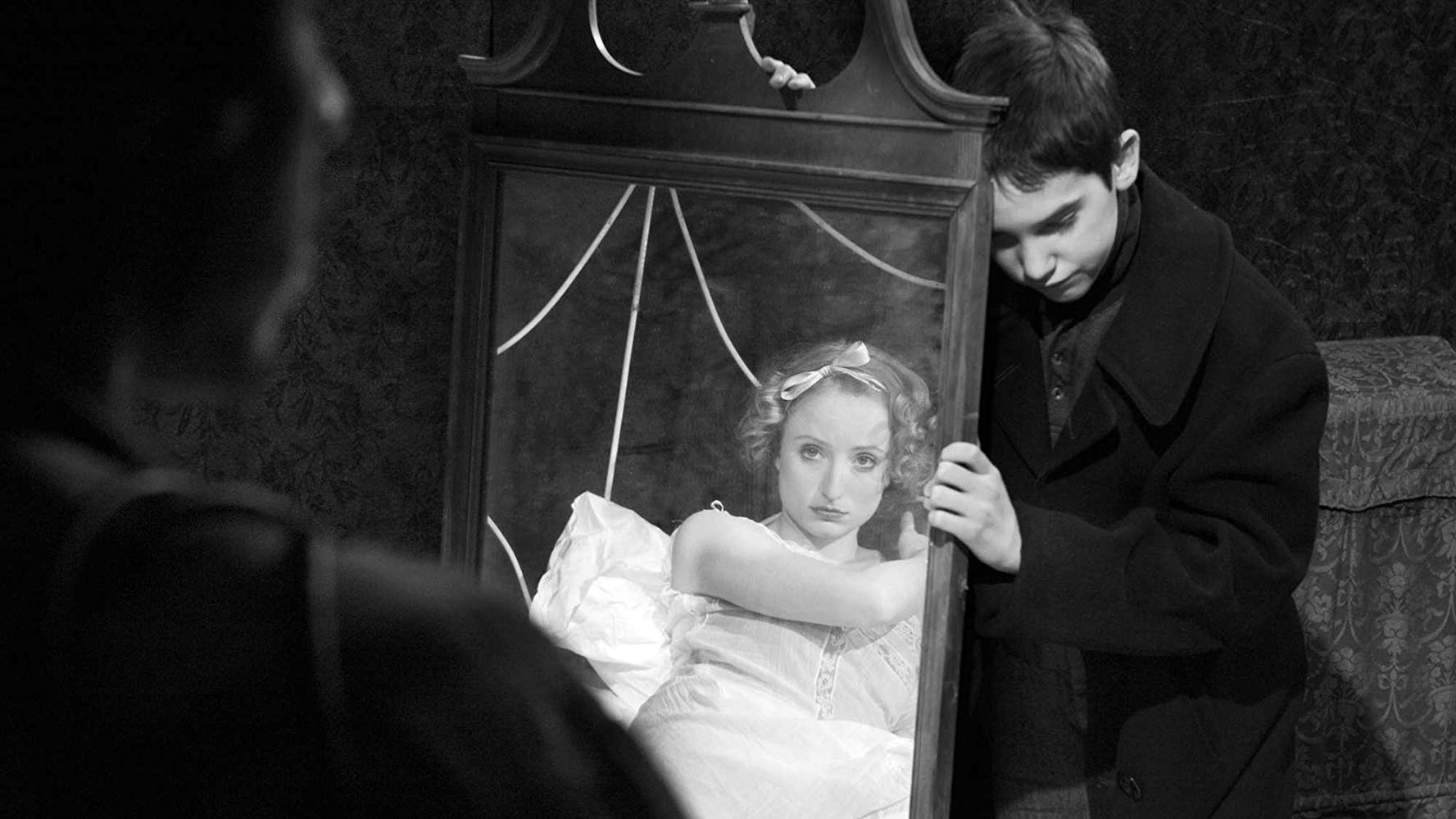 Sis (Maya Lawson) and the young Guy Maddin (Sullivan Brown) in Brand Upon the Brain! (2006)