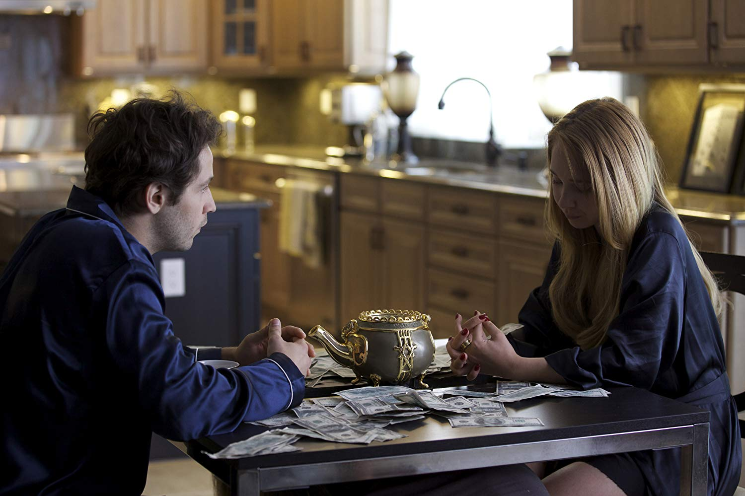 Husband and wife Michael Angarano and Juno Temple with the brass teapot in The Brass Teapot (2012)