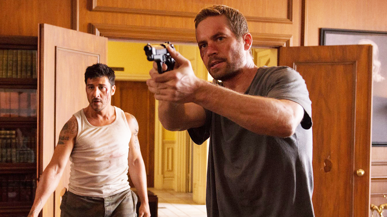 (l to r) Escaped prisoner David Belle and detective Paul Walker in Brick Mansions (2014)